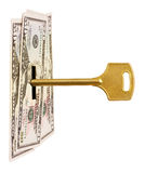 Key and money. Isolated on white background Royalty Free Stock Photo
