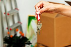 Key when moving a house. The key to an apartment with the move. new tenant moves Stock Image