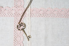 Key, natural linen fabric and lace Royalty Free Stock Images