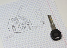 Key for the new home. Children's drawing of a house on the notebook sheet Royalty Free Stock Photography