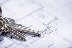 Key for new house on architect drawings Stock Image