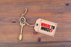 Key and a note. Where To Invest Stock Images