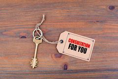 Key and a note on a wooden table with text - Consultation For Yo Royalty Free Stock Photo