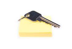 Key on notepad isolated Stock Images
