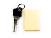 Key and notepad isolated on white Stock Photography