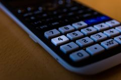 Key number four of the keyboard of a scientific calculator stock photo