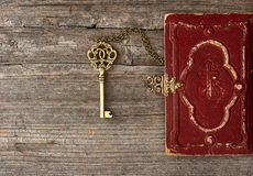 Key and old bible book cover royalty free stock images