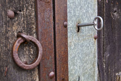 Key in a old door Royalty Free Stock Images