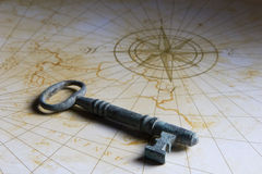 Key on old historic map Stock Photography
