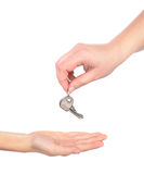 Key from one hand to another Stock Image