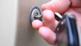 Key open car trunk closeup stock video footage