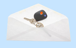 The key in open mail envelop. Stock Photos