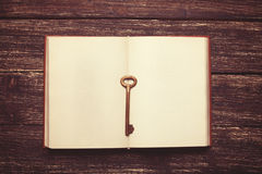 Key and opened book Royalty Free Stock Images
