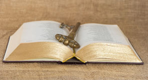 Key and opened old bible Royalty Free Stock Photos