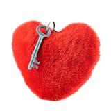 Key over a plush heart Royalty Free Stock Photos