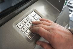 Cash machine key pad atm with hand stock illustration