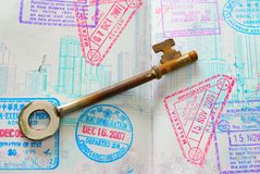 Key on passport full of stamps Royalty Free Stock Photos