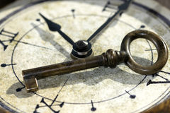 The key of the past. Concept of the key of the past with a key and an old watch Stock Image