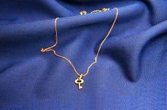 Key pendant on velvet background Stock Image