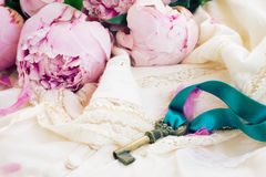 Key with peony flowers Royalty Free Stock Photos