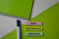 Key Performance Indicator KPI text on top view office desk table of Business workplace and business objects stock photography