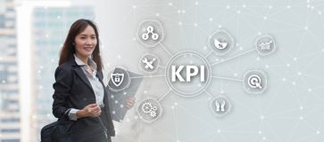 Key Performance Indicator KPI using Business Background with i. Nfographic versus planned target, person touching screen icon, success concept Stock Images