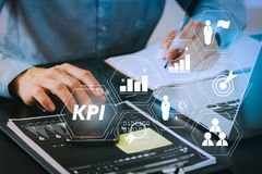 Close up of businessman working with smart phone and digital tab. Key Performance Indicator (KPI) workinng with Business Intelligence (BI) metrics to measure Royalty Free Stock Image