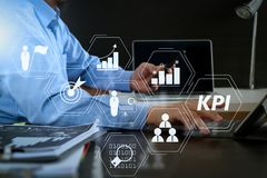 Businessman working with smart phone and digital tablet and lapt. Key Performance Indicator (KPI) workinng with Business Intelligence (BI) metrics to measure Royalty Free Stock Images