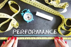 Key performance indicator or measure performance concept with ruler on chalkboard stock image