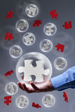 The key piece of a solution. Concept - puzzle pieces in glass bubbles Stock Photography