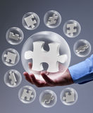 The key piece of a solution. Concept - puzzle pieces in glass bubbles Royalty Free Stock Photography