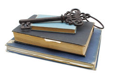 Key on pile books Royalty Free Stock Photos