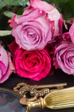 Key with pink roses Stock Photo