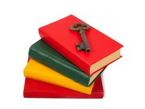 Key placed on pile of books Stock Images