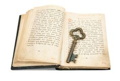 Key placed on vintage bible Royalty Free Stock Images
