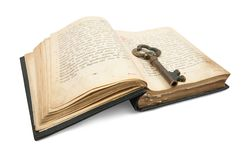 Key placed on vintage book. Key placed on an 18st century vintage book, isolated on white stock photo