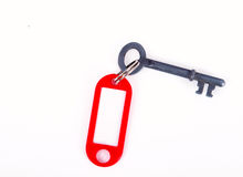 Key with plastic tag. Shaped silver key with plastic red tag Stock Photography
