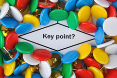 Key point question. Colorful drawing pin is surrounding a question about key point, could refer to any matters about key point defining Royalty Free Stock Photos