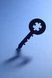 Key with puzzle code Stock Images