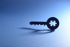 Key with puzzle code Stock Photos