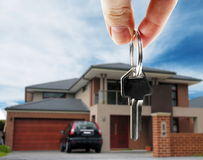 Key with real estate. Key in hand with real estate Stock Photo