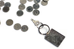 Key with rectangle key chain with Bath Coin. On white background Stock Images