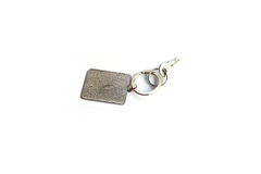 Key with rectangle key chain. On white background Stock Image