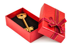 Key in red box. Gold key in red gift box on white background Royalty Free Stock Photography