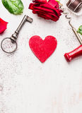 Key, red heart, rose and chocolate on white wooden table, love background Stock Image