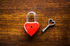 Key red heart on a wooden table, the concept of love and Valenti. Ne& x27;s Day royalty free stock photos