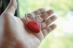 Key red hearts on hand, the concept of Valentine& x27;s Day. royalty free stock photography