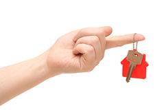 Key with red home shape on chain in hand Royalty Free Stock Images
