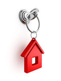 Key with red house trinket in keyhole Royalty Free Stock Image