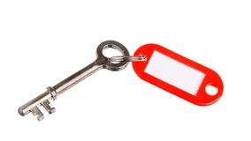 Key with red key ring Royalty Free Stock Photos
